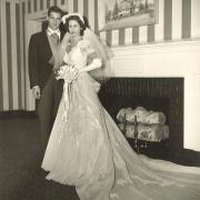 October 21, 1950. Newlyweds Pat & Cookie Marinello stand in front of the Mantle at Mayfair Farms on their wedding day.